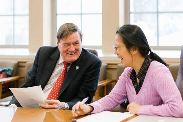 Gill Center Director, Hui-Chen Lu, and Donor, Jack Gill, talking in Gill Conference Room